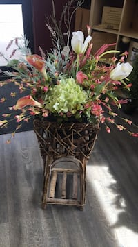Beautiful pink and green arrangement. Stand not included