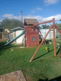 brown and green wooden slide and swing Dallas, 75265