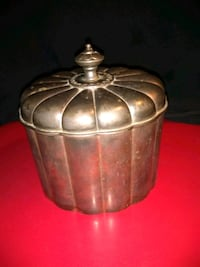 Silver container with red felt liner