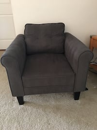 gray fabric sofa chair with throw pillow