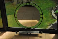 Steel frame mirror with candle holders Media