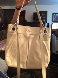 beige Coach shoulder bag