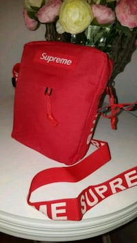 red and black Supreme backpack Laval, H7W