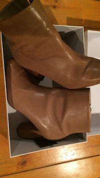 women's pair of brown leather boots