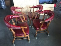 four red-and-brown padded tub chairs