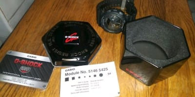 Brand new never worn g shock with metal tin and warranty card