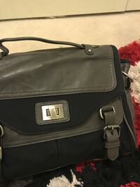gray and black leather satchel bag
