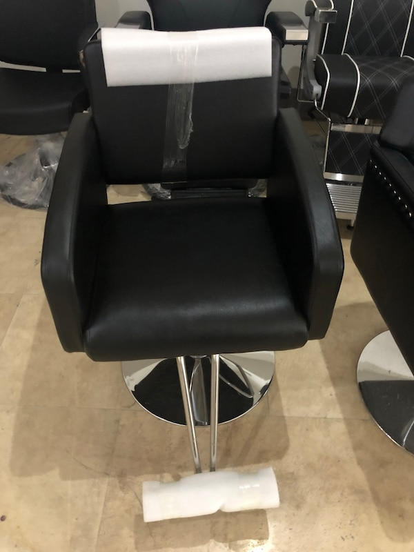 Black leather padded barber styling chair