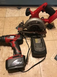 red and black cordless power drill saw and changer Deland, 32724