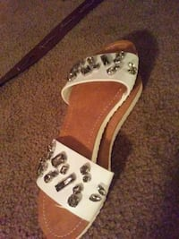 pair of white-and-brown slide sandals