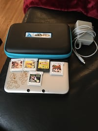 Perfect condition Mario and Luigi themed Nintendo 3DS and 6 games Airdrie, T4B 3S3