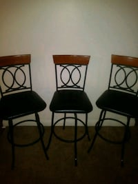 three black metal framed brown padded bar stools Las Vegas, 89128