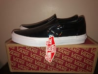 pair of black Vans slip-on shoes with box Toronto