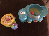 toddler's two teal and yellow Fisher-Price learning toys