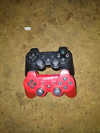 two black and red Sony PS4 controllers Portland