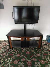 black flat screen TV with black wooden TV stand Ocala, 34473