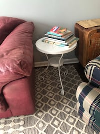 End table made of metal, from ikea. Originally black but is painted white. Decorative holes in the top.  Ashburn, 20147