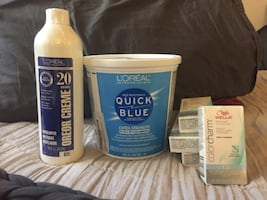 L'Oreal Quick Blue bleach power, L'Oreal 20 Vol Developer, and 4 boxes of Wella Color Charm T18 (lightest Ash Blond)