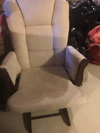 Beige rocker. Comes with ottoman foot stool