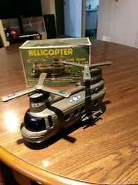 gray helicopter scale model with box Laval, H7L 3C3