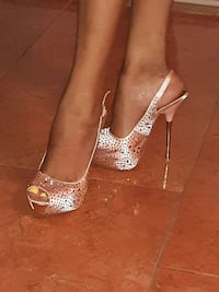 pair of gold-colored peep-toe platform stilettos 955 mi