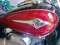 red and black motorcycle helmet Laval, H7X 1E9