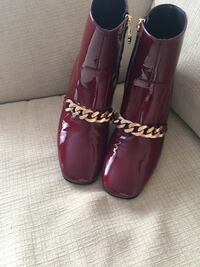 pair of red patent leather boots