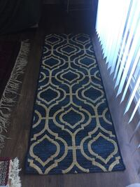 Navy blue and tan runner rug