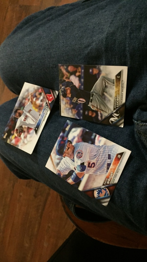 three assorted baseball trading cards