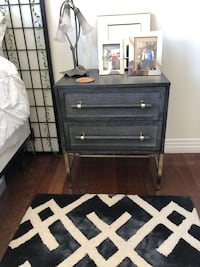 Black Side table with rattan accents