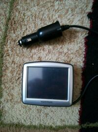 black Tomtom GPS navigator with car charger