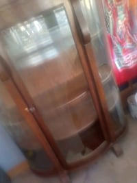 Antique hutch over a hundred years old. Does have broken glass