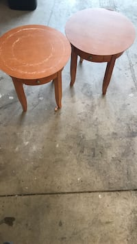Two round brown wooden tables