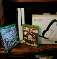 Xbox One console with controller and game cases Fresno, 93704