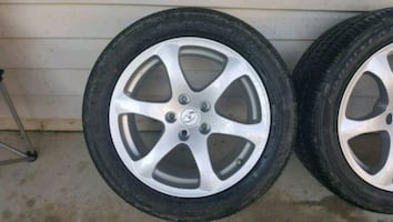Infiniti G37 staggered wheel set with Goodyear tires New car takeoffs