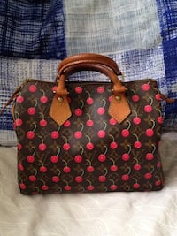 Authentic Louis Vuitton Limited Edition Cerises Speedy 25 Satchel.