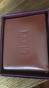 brown Gucci leather bifold wallet