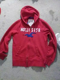 red and white Hollister zip up hoodie SeaTac, 98188