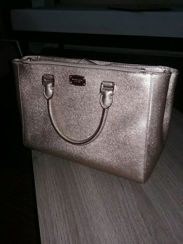 386a87d1748fe Used Michael Kors rose gold purse for sale in Stockbridge - letgo