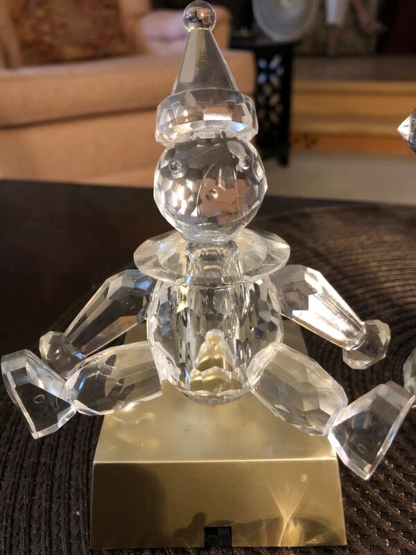 Crystal / glass decor pieces.  Baby rattle , clown that sits on a color changing base  apple that might be Swarovski  take all with delivery for $20  e43b0988-df60-4a17-bb98-4de378a849e3