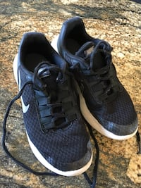Pair of black and-white nike running shoes