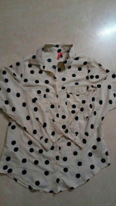 beige and black polka dot polo shirt