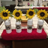 Four white glass bottles with yellow sunflowers Kingsburg, 93631