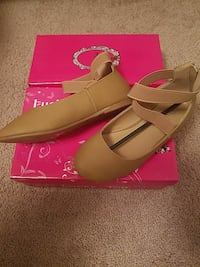 pair of brown leather flats shoes with box