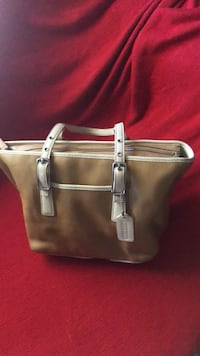 Women's brown leather tote bag coach