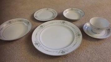 Dishes... 10 place setting of beautiful dishes plus serving dishes.