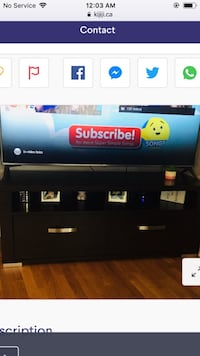 black flat screen TV with remote 539 km