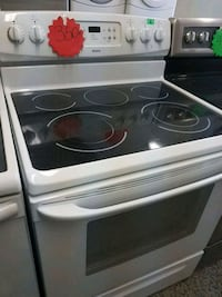 white and black induction range oven Laval, H7G 2S3