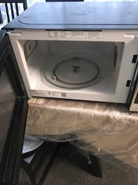white and gray microwave oven 57 km