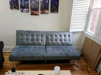 Foldable gray loveseat futon  47 km